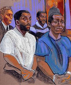 Three of the suspects and an attorney in court