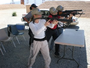 Ladies learning to shoot at stiletto spy school