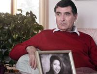 Reza Saberi with a photo of his daughter Roxana